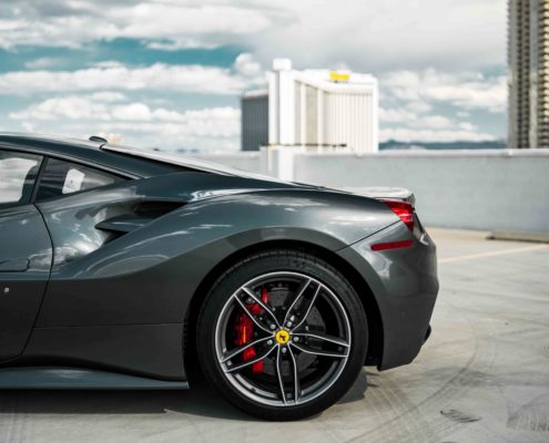 back end of dark gray Ferrari Couple 488