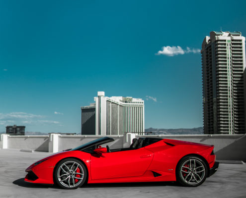 side view of red Lamborghini Huracan