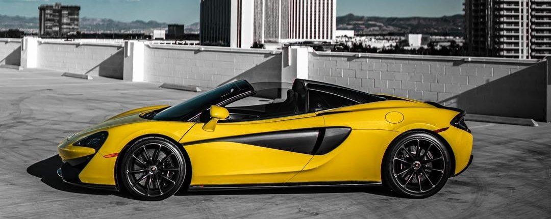 side view of yellow McLaren 570S