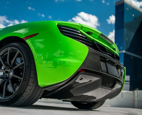 front bumper of green McLaren 650S
