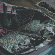 A sports car with a broken windshield